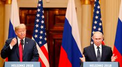 U.S. President Donald Trump and Russian President Vladimir Putin hold a joint news conference after their meeting in Helsinki, July 16, 2018. REUTERS/Grigory Dukor
