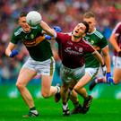 Galway's Ian Burke in action against Kerry duo Jason Foley (left) and Peter Crowley on a day the Tribesmen were almost always first to the ball. Photo: Piaras Ó Mídheach/Sportsfile