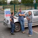 School building subcontractors Brian O'Carroll, John Foran and Lar Conway outside Coláiste Raithin in Bray, Co Wicklow