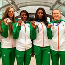 Sprinter Rhasidat Adeleke, high jumper Sommer Lecky, and sprinters Gina Akpe-Moses, Patience Jumbo-Gula, Ciara Neville, and Molly Scott on their return from Finland at Dublin Airport yesterday. Picture: Sportsfile