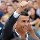 Cristiano Ronaldo salutes Juventus supporters as he arrives to undergo his medical checks in Turin yesterday Luca Bruno Photo: AP
