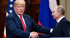 U.S. President Donald Trump and Russian President Vladimir Putin shake hands after a joint press conference at the Presidential Palace in Helsinki (Jussi Nukari/Lehtikuva via AP)