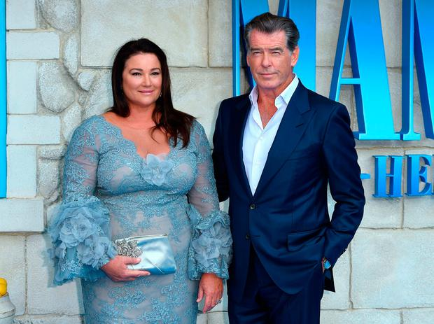 5fec59e0d ... Mamma Mia premiere. Pierce Brosnan and wife Keely Shaye Smith pose on  the red carpet upon arrival for the