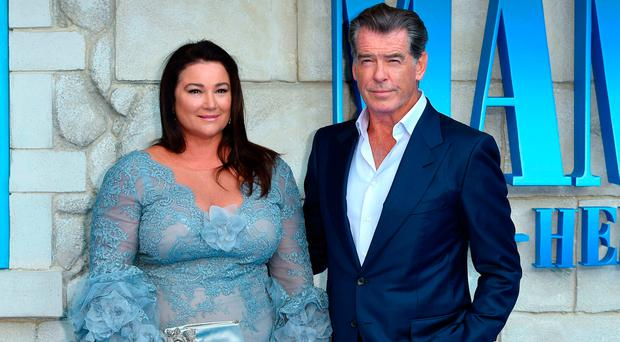 Pierce Brosnan and wife Keely Shaye Smith pose on the red carpet upon arrival for the world premiere of the film