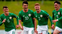 Troy Parrott, 10, of Republic of Ireland celebrates scoring with teammates from left, Jason Knight, Cameron Ledwidge and Barry Coffey during the UEFA U17 Championship Finals Group C match between Bosnia & Herzegovina and Republic of Ireland at St George's Park, in Burton-upon-Trent, England. Photo: Malcolm Couzens/Sportsfile