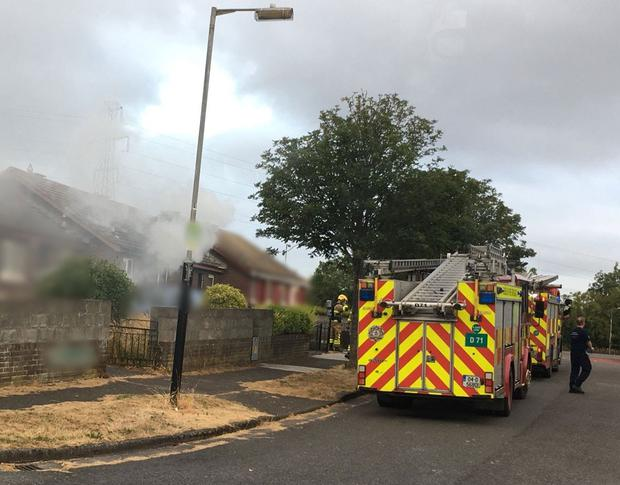 Firefighters attend to a house fire in Tallaght yesterday morning