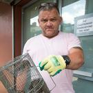 Marmion Court resident Paul Maguire with rats he caught at the Blackhall Street complex yesterday. Photo: Colin O'Riordan