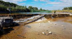 Two photos of Keel Weir in Achill Island, Co Mayo, showing the normal water level and, pictured, the low level in the current drought. The fish pass for salmon is completely dry.