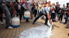 Protesters dump milk during a rally against the government-ordered mass slaughter of sheep and goats following the first outbreak in the European Union of the highly contagious Peste des Petits Ruminants (PPR) in Sofia, Bulgaria, July 18, 2018. REUTERS/Dimitar Kyosemarliev