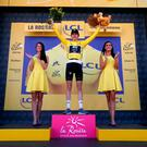 Stage winner Britain's Geraint Thomas and new overall leader celebrates on the podium after the eleventh stage of the Tour de France cycling race over 108.5 kilometers (67.4 miles) with start in Albertville and finish in La Rosiere Espace San Bernardo, France. (AP Photo/Christophe Ena )
