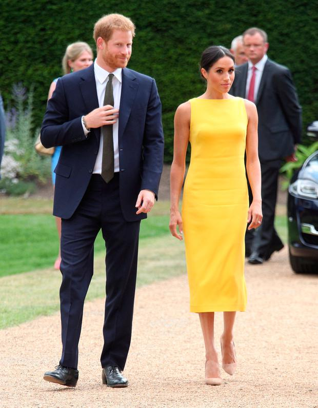 Meghan Markle, in sunshine yellow Brandon Maxwell, illustrates how wearing one colour head-to-toe can have a leg-lengthening effect. Photo: Reuters