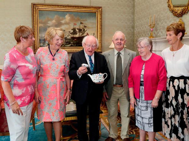 President Michael D Higgins hosted a special afternoon tea to honour community groups yesterday. But he didn't have to dust off the Áras china after members of the Liscarroll Social Satellite Group, from Co Cork, Mary Ann O'Brien, Jerry Murphy, Joan Buckely and Christine Brosnan, presented Mr Higgins and wife Sabina with a customised teapot. Photo: Maxwell Photography