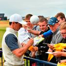 Rory McIlroy signs autographs for fans at Carnoustie yesterday. Photo: Glyn Kirk/AFP/Getty