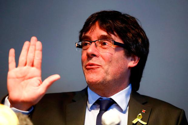 FILE PHOTO: Catalonia's former leader Carles Puigdemont gestures during a news conference in Berlin, Germany, April 7, 2018. REUTERS/Hannibal Hanschke/File Photo