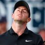 Reaction: Rory McIlroy shows his unhappiness after his play on the 18th green during day one of the British Open at Carnoustie