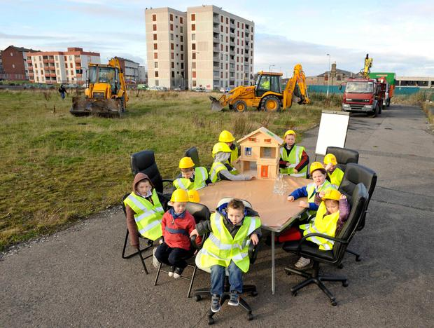 Children in hard hats at St Michael's Estate, which is set to be redeveloped. Inset, the proposed St Patrick's stadium 'was never a runner' Photo: Sasko Lazarov/Photocall Ireland