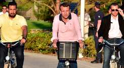 Emmanuel Macron, centre, is joined by senior security officer Alexandre Benalla, left, on a bike ride in Le Touquet last summer. Photo: Getty Images