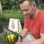 Fionn Davenport with a krathong, a flower ship given to him at the hotel where he was staying in Thailand when he learned of his father's passing.