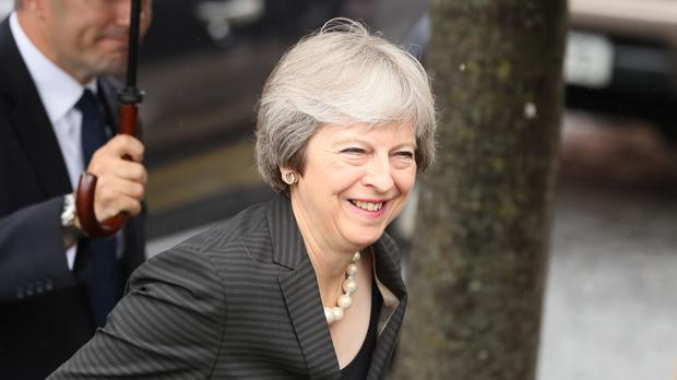 Theresa May on a visit to Belfast (Brian Lawless/PA)