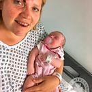 Undated handout photo taken from the Twitter page of West Midlands Police of Clare O'Neill and her baby Eliza, after the four-week-old girl was inside an Audi which taken in a car-jacking in Birmingham. West Midlands Police/PA Wire