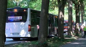 A bus stands on a street in Luebeck, northern Germany after a man attacked people inside. (TNN/dpa via AP)