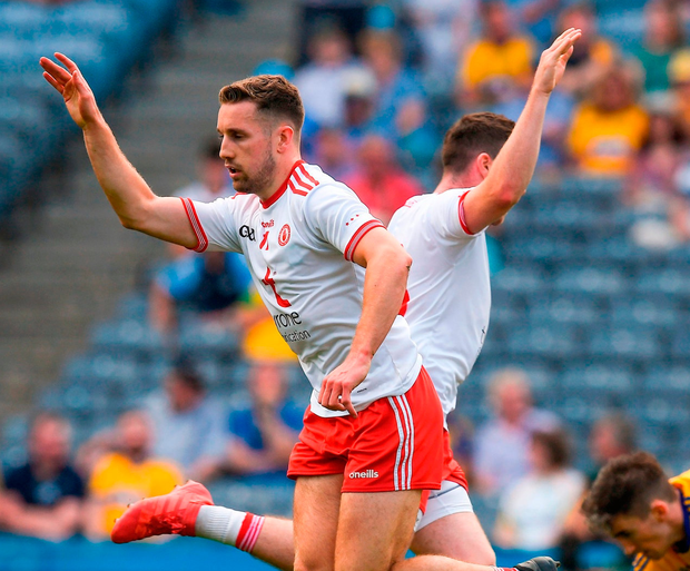 Tyrone's Niall Sludden celebrates with team-mate Connor McAliskey after scoring his team's opening goal against Roscommon last weekend. Photo: Ray McManus/Sportsfile