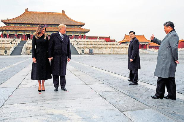 US President Donald Trump and First Lady Melania visit the Forbidden City in Beijing with China's President Xi Jinping last year. Photo: Jonathan Ernst/Reuters