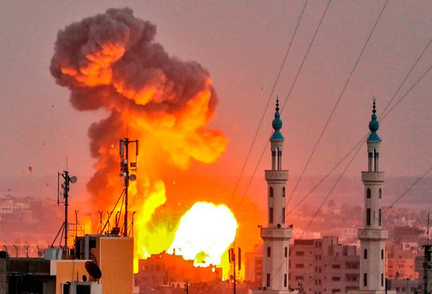 A fireball exploding in Gaza City during Israeli bombardment. Photo: Bashar Talebbashar Taleb/Getty