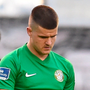 A dejected Jake Kelly walks away as Bohemians players celebrate after scoring their fifth goal at Dalymount Park. Photo: Sportsfile