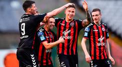 Rob Cornwall of Bohemians, second right, is congratulated by team-mates, from left, Dinny Corcoran and Keith Ward