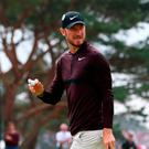 England's Chris Wood reacts after a birdie on the 10th