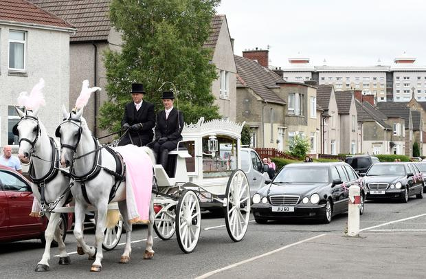 Funeral cortege arrives at the Coats Funeral Home, in Coatbridge, prior to the funeral of six-year-old Alesha MacPhail Photo: Lesley Martin/PA Wire