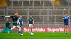 Rory Beggan of Monaghan kicks a free in front of a deserted Hill 16 at Croke Park last Sunday. Photo: Sportsfile