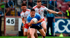 Con O'Callaghan in action against Tyrone players Pádraig Hampsey and Declan McClure during last night's Super 8 match in Omagh. Photo: Sportsfile
