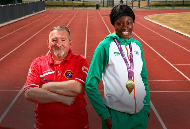Fifteen-year-old Rhasidat Adeleke, who won the 200m gold medal at the European Youth Championships, with her coach Johnny Fox at the Tallaght Athletics Club. Photo: Frank McGrath