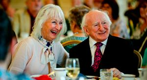 INCUMBENT: President Michael D Higgins shares a laugh with Deena Cotter from Dun Laoghaire as he hosts an afternoon tea for community groups in Aras An Uachtarain — now a wide range of potential candidates are lining up to challenge him for the presidency. Photo: Maxwell