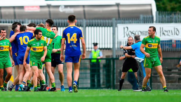 Kevin McStay (background, right) remonstrates with linesman Niall Cullen during Roscommon's match against Donegal at Dr Hyde Park. Photo by David Fitzgerald/Sportsfile