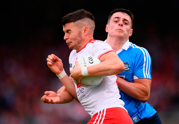 Richard Donnelly of Tyrone in action against Brian Howard of Dublin. Photo by Stephen McCarthy/Sportsfile