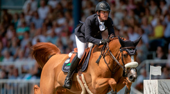 Ireland's Darragh Kenny riding Babalou 41 competes in the Rolex Grand Prix at the World Equestrian Festival in Aachen, Germany. Photo: Steve Parsons/PA