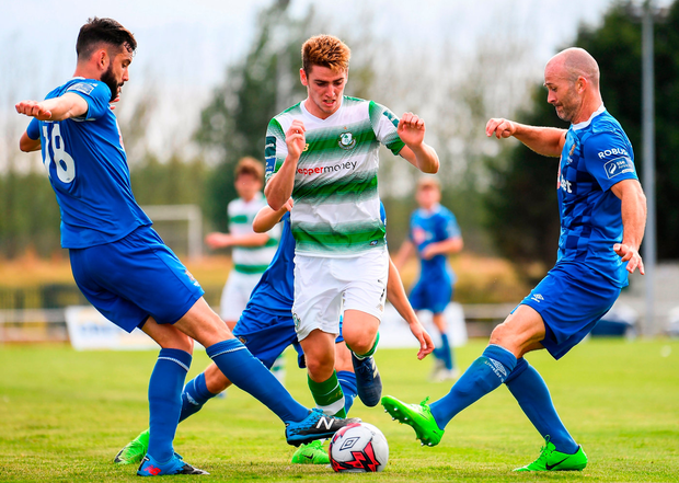 Dylan Watts of Shamrock Rovers in action against David Webster, left, and Paul Keegan of Waterford. Photo: Stephen McCarthy/Sportsfile