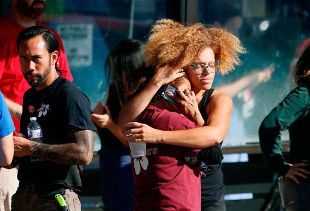 Rescued Trader Joe's employees comfort each other. Photo: AP