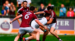 Niall Kelly is crowded out by Galway'sGareth Bradshaw (left) and Johnny Duane. Photo by Sam Barnes/Sportsfile