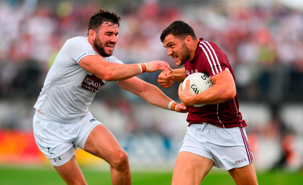 Damien Comer of Galway shows his determination as he takes on Kildare's Fergal Conway (left). Photo by Sam Barnes/Sportsfile
