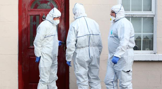 Forensic gardaí at the home of Rosie Hanrahan after her brutal murder in Co Limerick