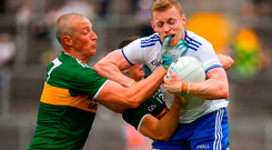 Colin Walshe of Monaghan in action against Kieran Donaghy of Kerry. Photo by Brendan Moran/Sportsfile