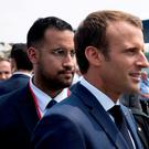 FILE PHOTO: French President Emmanuel Macron walks ahead of his aide Alexandre Benalla at the end of the Bastille Day military parade in Paris, France, July 14, 2018. REUTERS/Philippe Wojazer/