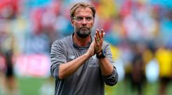 Liverpool Coach Jurgen Klopp applauds the fans after the second half of an International Champions Cup soccer match between Liverpool and the Borussia Dortmund at Bank of America Stadium. Credit: Jim Dedmon-USA TODAY Sports