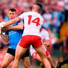 Darren Daly of Dublin in action against Richard Donnelly of Tyrone and (inset) Spillane and Brolly