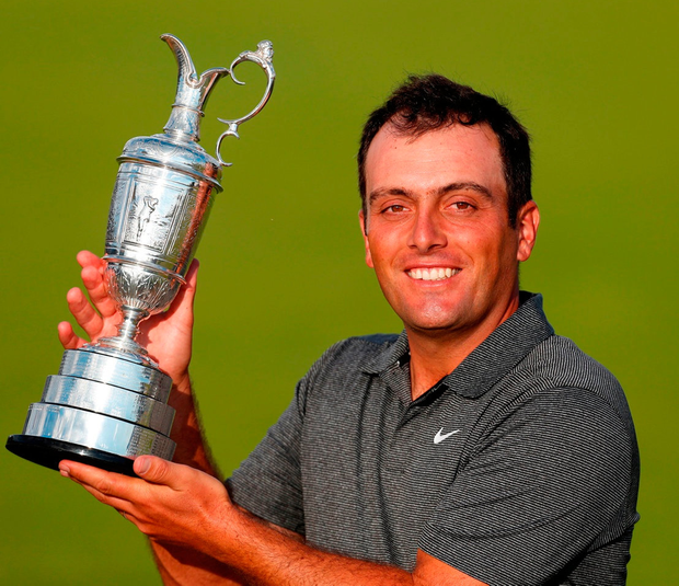 Francesco Molinari celebrates with the Claret Jug after winning the Open at Carnoustie. Photo: Paul Childs/Reuters