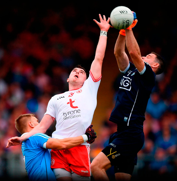 NEW HEIGHTS: Tyrone's Cathal McShane contests a high ball with Dublin captain Stephen Cluxton, with Jonny Cooper in support in Omagh on Saturday. Photo: Stephen McCarthy/Sportsfile